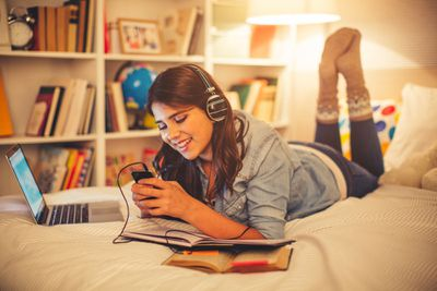 Student listening to music on a smartphone