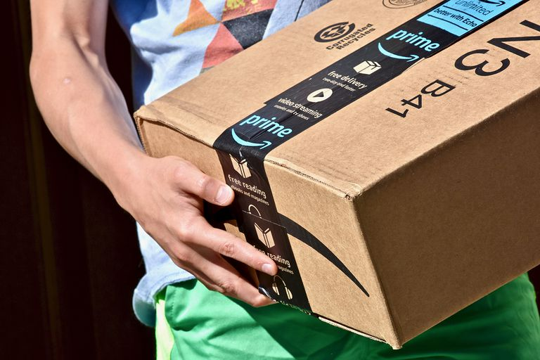 Amazon prime box being held by person