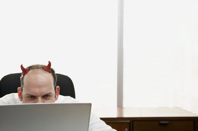 An image of an obvious internet troll wearing devil's horns.