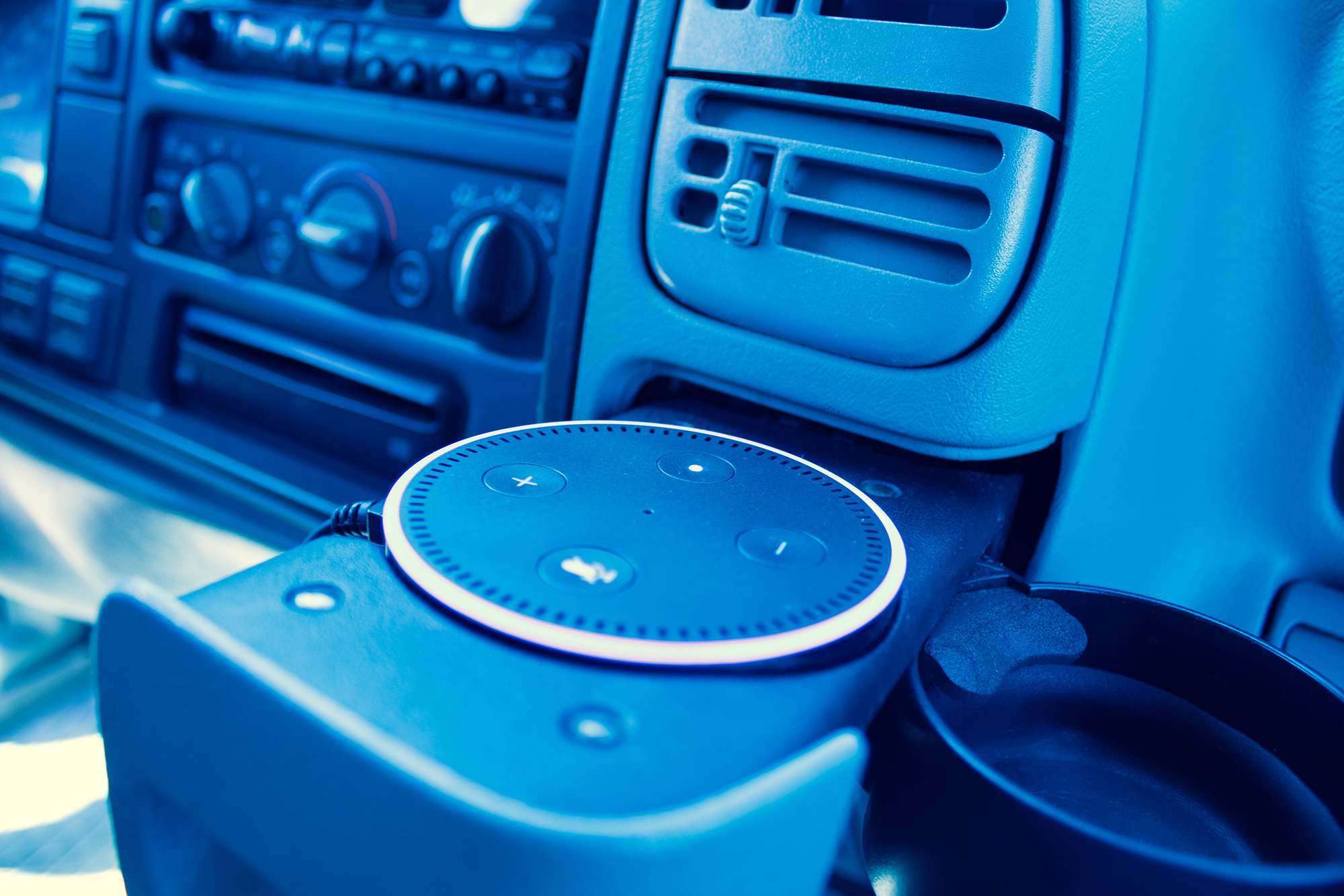 An Echo Dot in use in a vehicle.