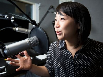 Podcaster speaking into a microphone