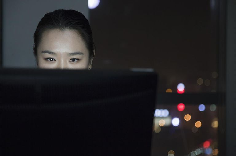 Woman working late at her computer
