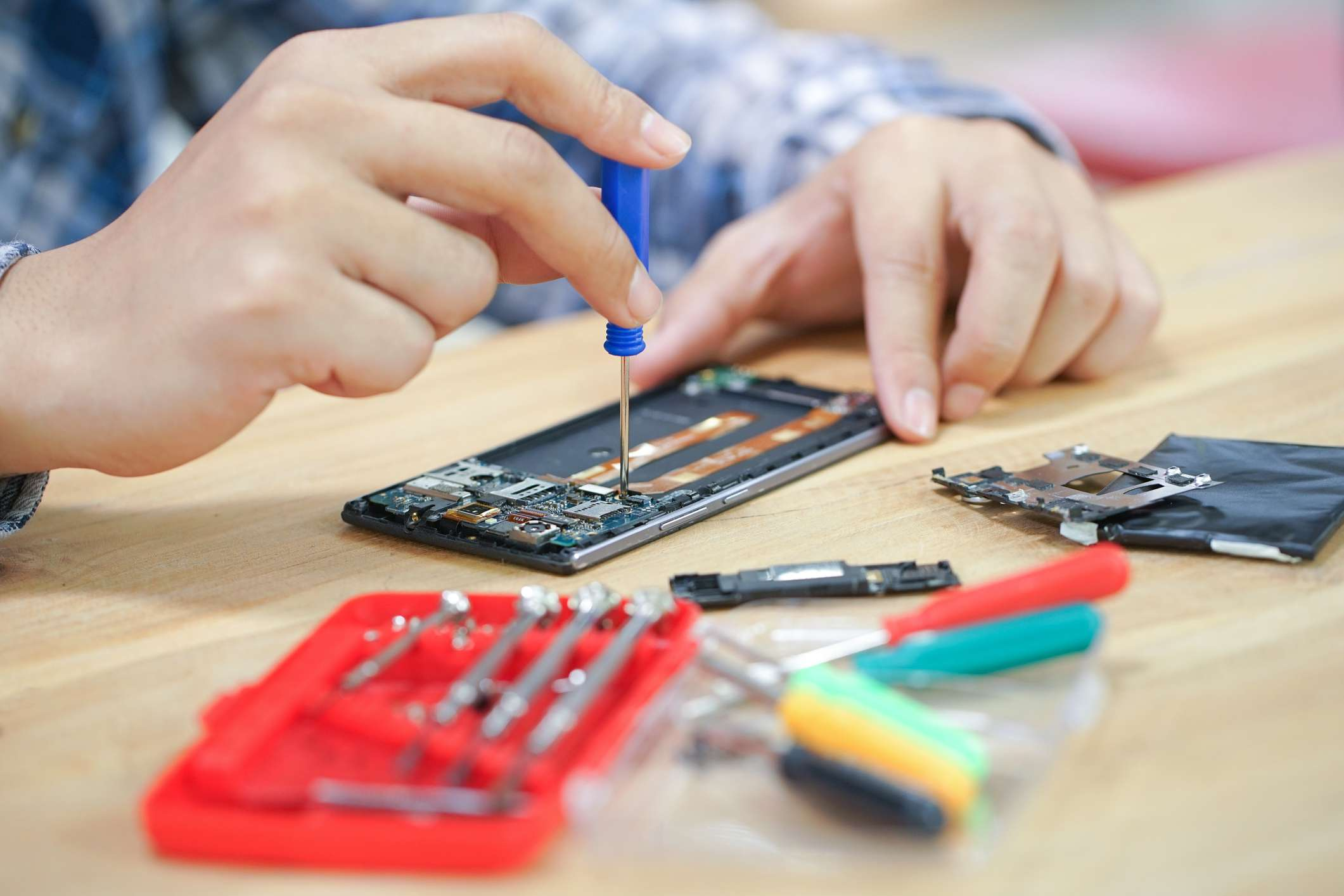 Someone repairing a cellphone.