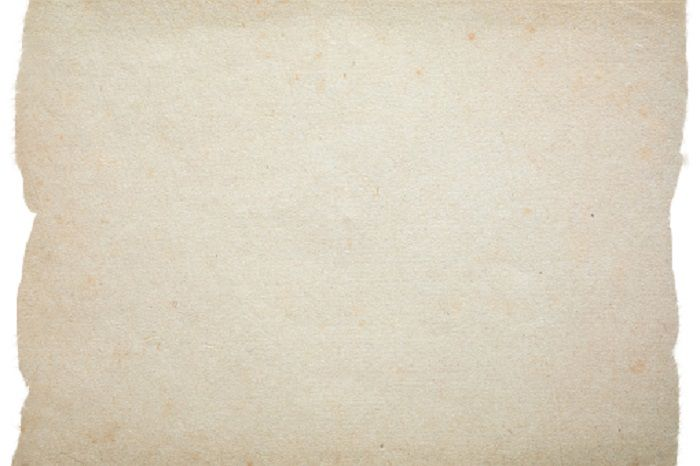 A piece of parchment paper with torn edges created in Photoshop CC 2019