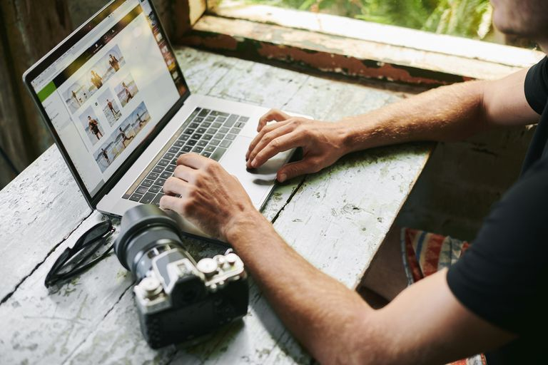 A photographer getting ready to edit images on his computer.