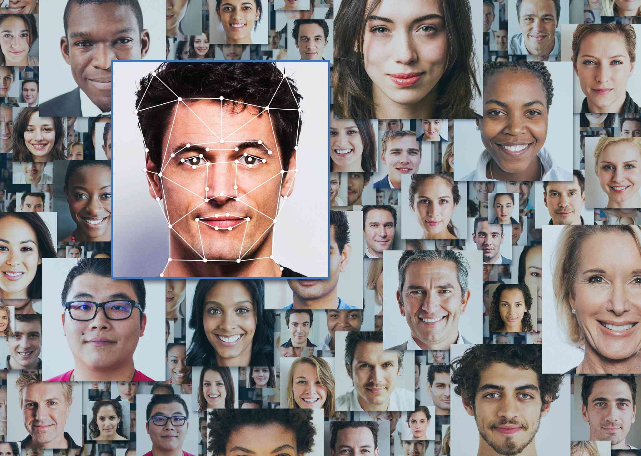 Many portraits of diverse people on in front being scanned by facial recognition technology.