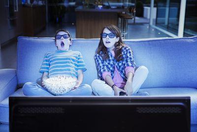 2 kids watching a movie