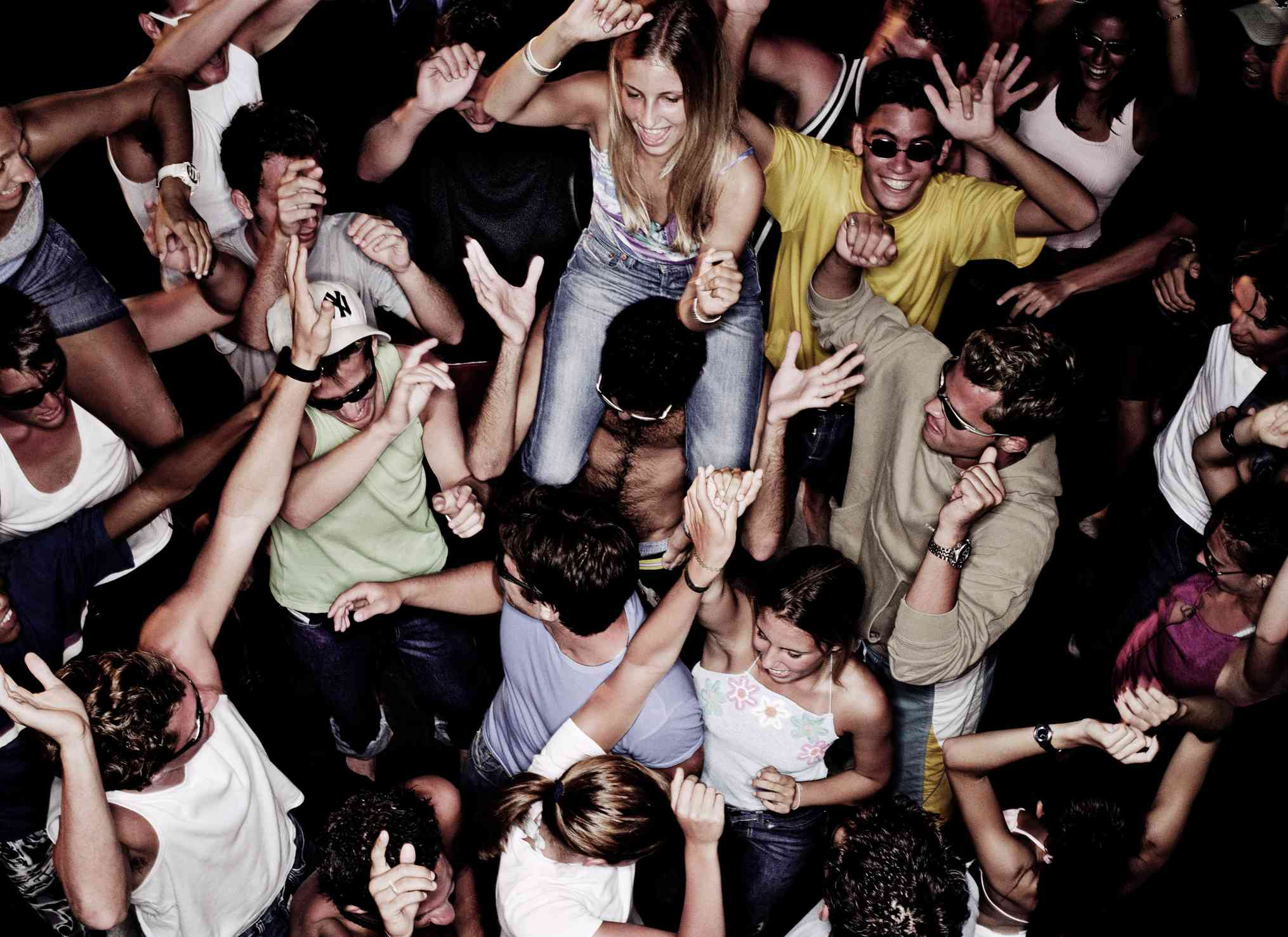Crowd of people dancing as seen from above