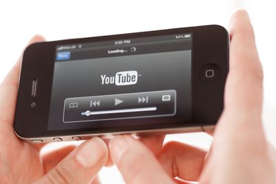 An image of someone playing a YouTube video on a smartphone