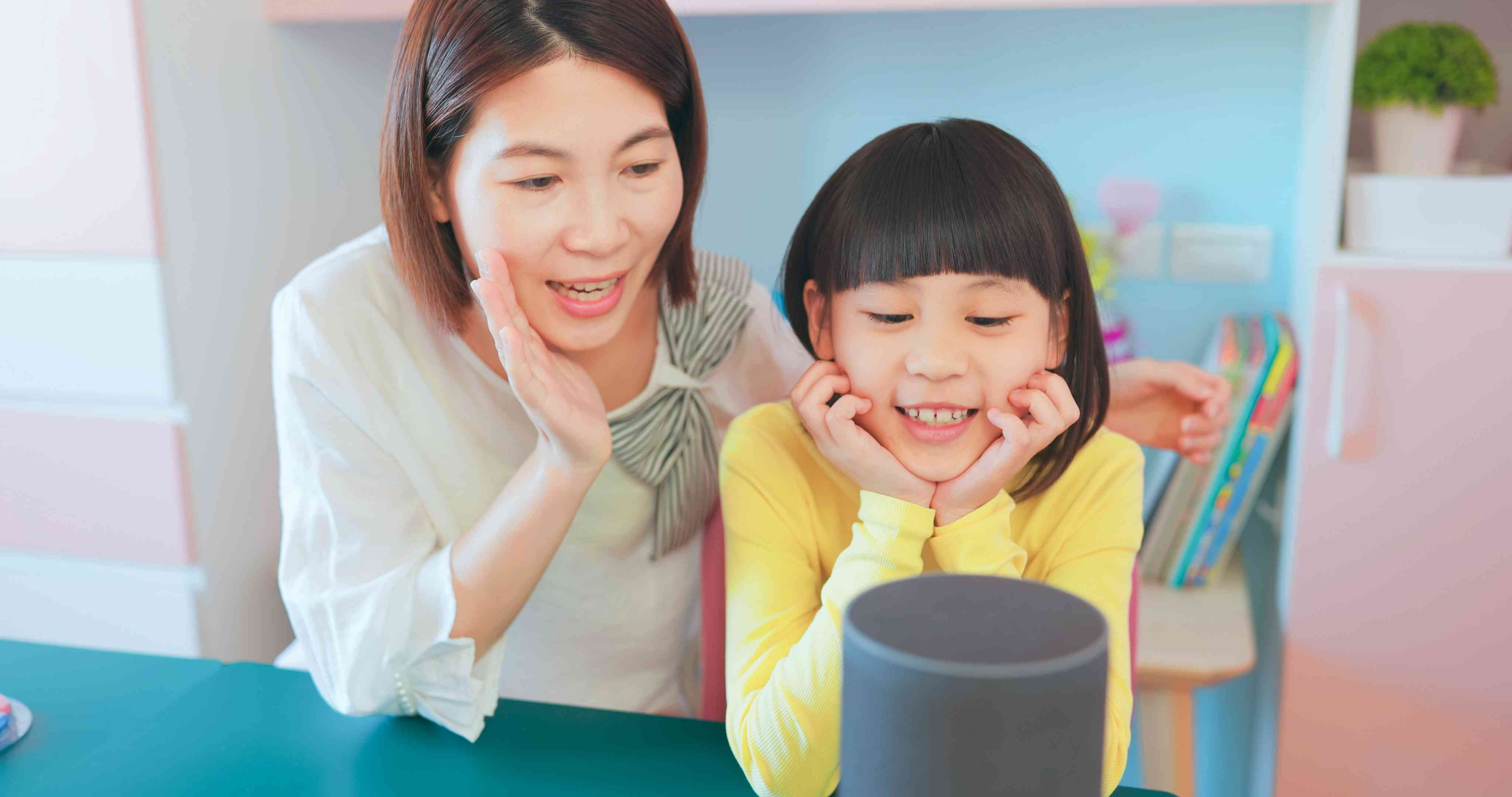 Woman and child talking to smart home device