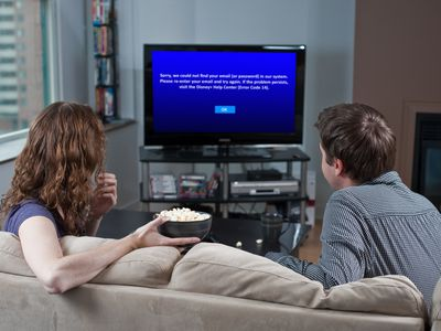 A couple sees Disney Plus error code 14 on their television.