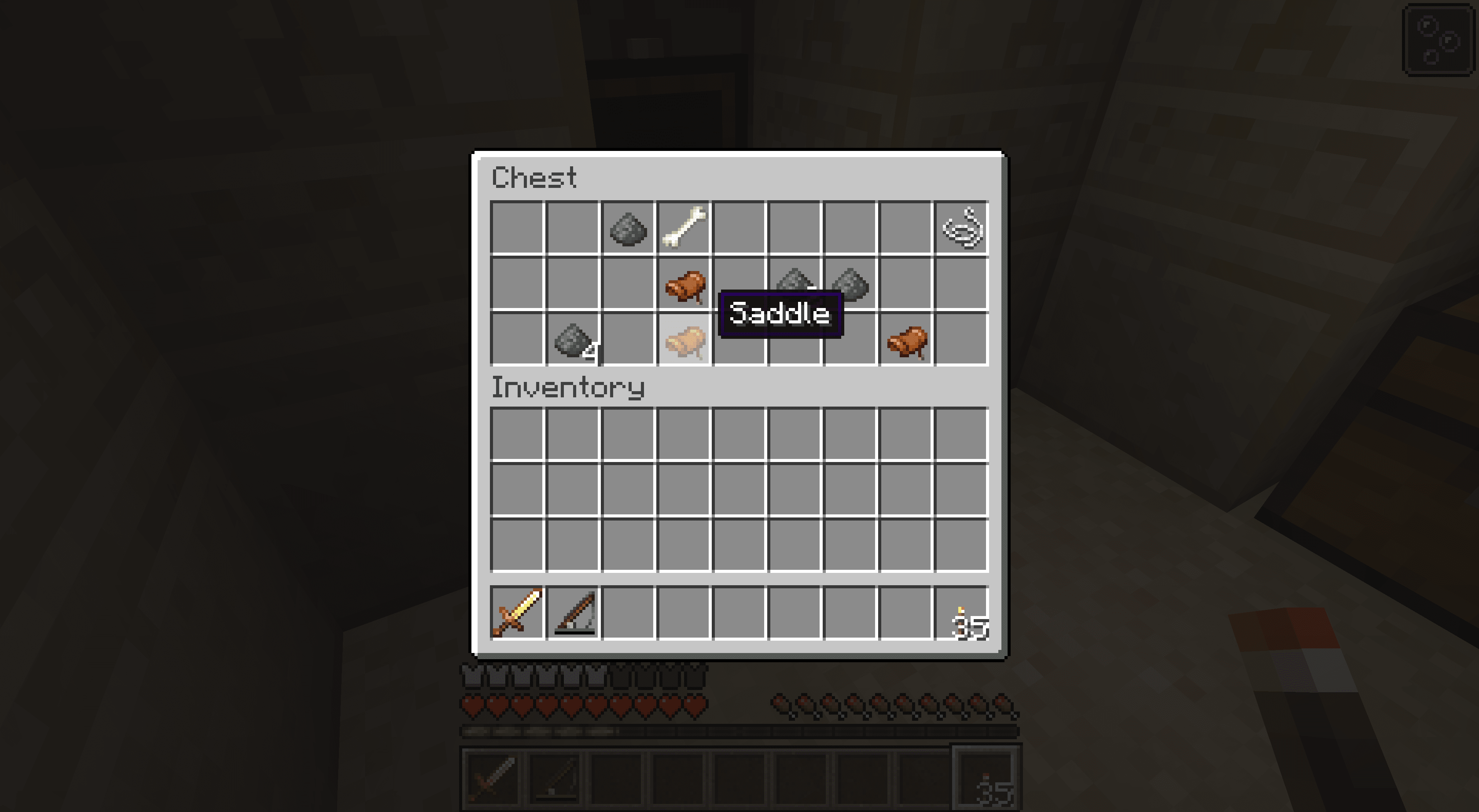 Saddles in a chest in Minecraft.