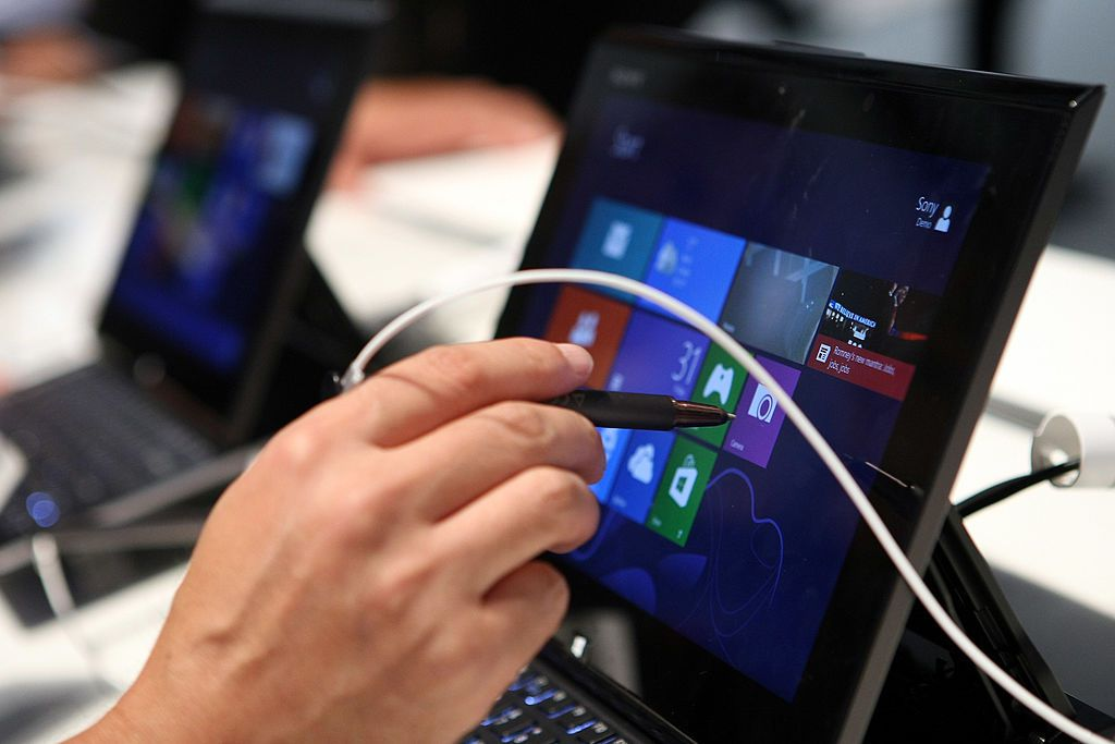 A person using a stylus with a Windows-based PC.