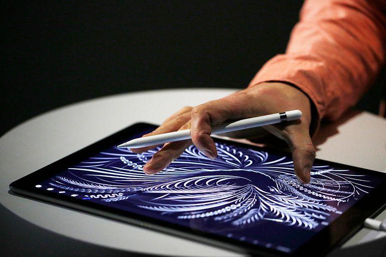 Man uses Apple Pencil on iPad Pro