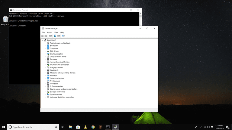 Command Prompt and Device Manager open on a Windows 10 desktop