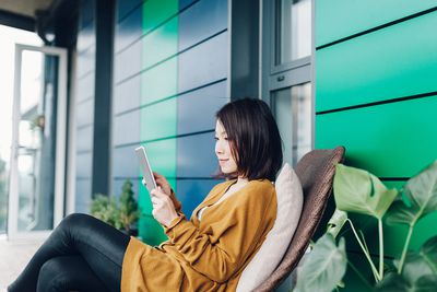 Young lady reading news on tablet