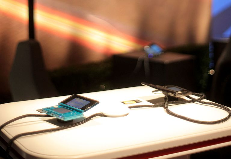 Two Nintendo 3DS systems on a table
