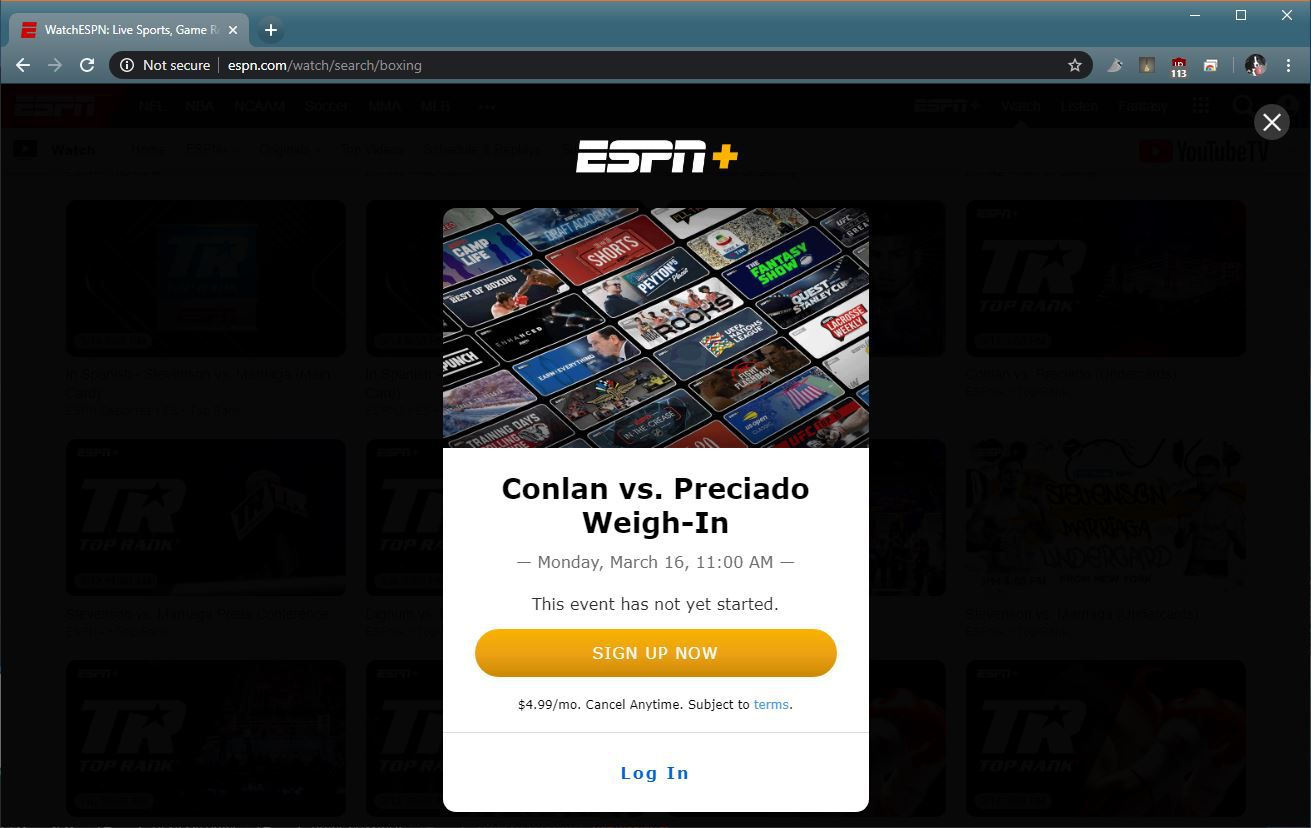 A screenshot of ESPN+ and a boxing match.