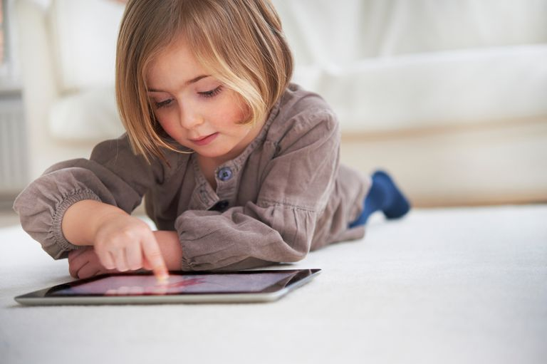 Picture of a toddler using apps on an iPad.
