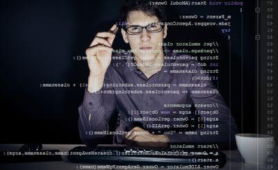 Software Developer Using Transparent Computer Screen At Office