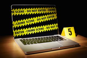 Laptop wrapped in crime scene tape
