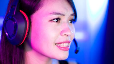 Gamer wearing a gaming headset with a mic while playing a video game on an Xbox One.