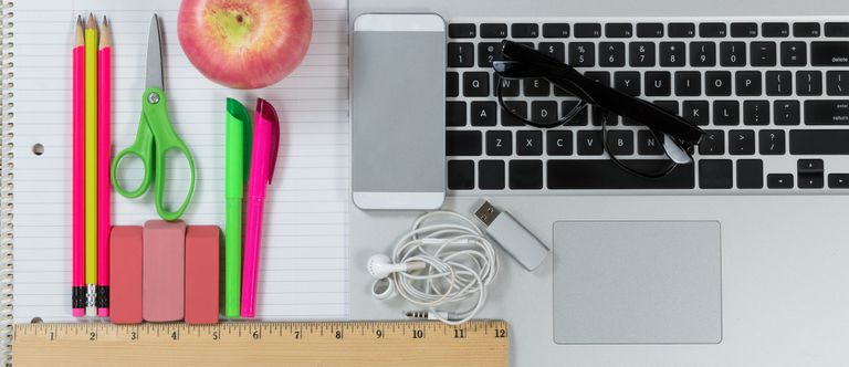 Pencils, paper, smartphone, keyboard, ruler laid out