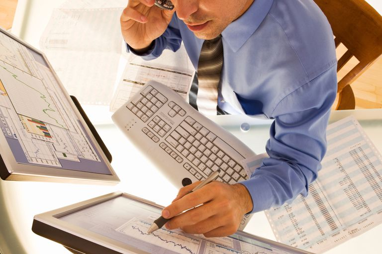 Image of a person working with spreadsheet data
