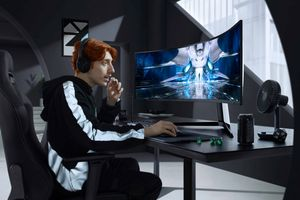 Someone gaming with the Samsung Odyssey NEO G9 Monitor.