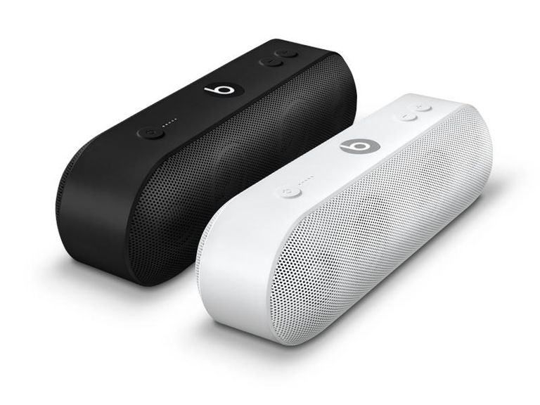 Back and white Beats Pill+ Bluetooth speakers, placed side by side