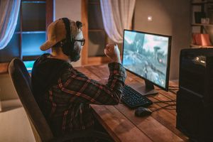 Teenager playing game on PC
