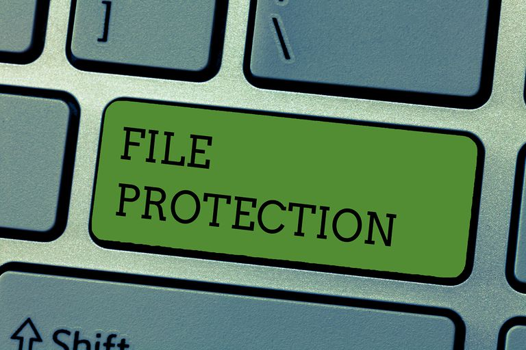 Writing note showing File Protection. Business photo showcasing Preventing accidental erasing of data using storage medium