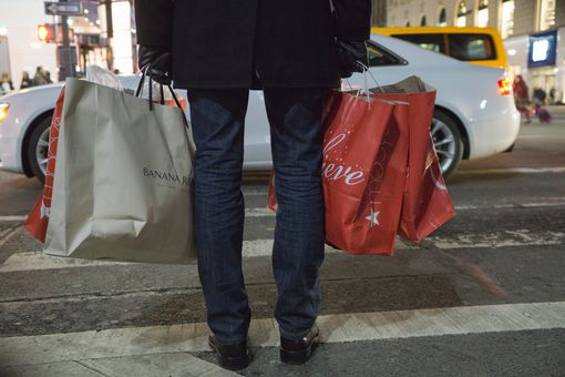 A man carries shopping bags on Black Friday. Get the facts on Black Friday 2016 here.