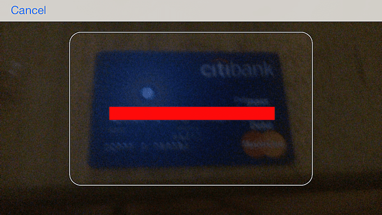 iPhone scanning a credit card in iOS 8