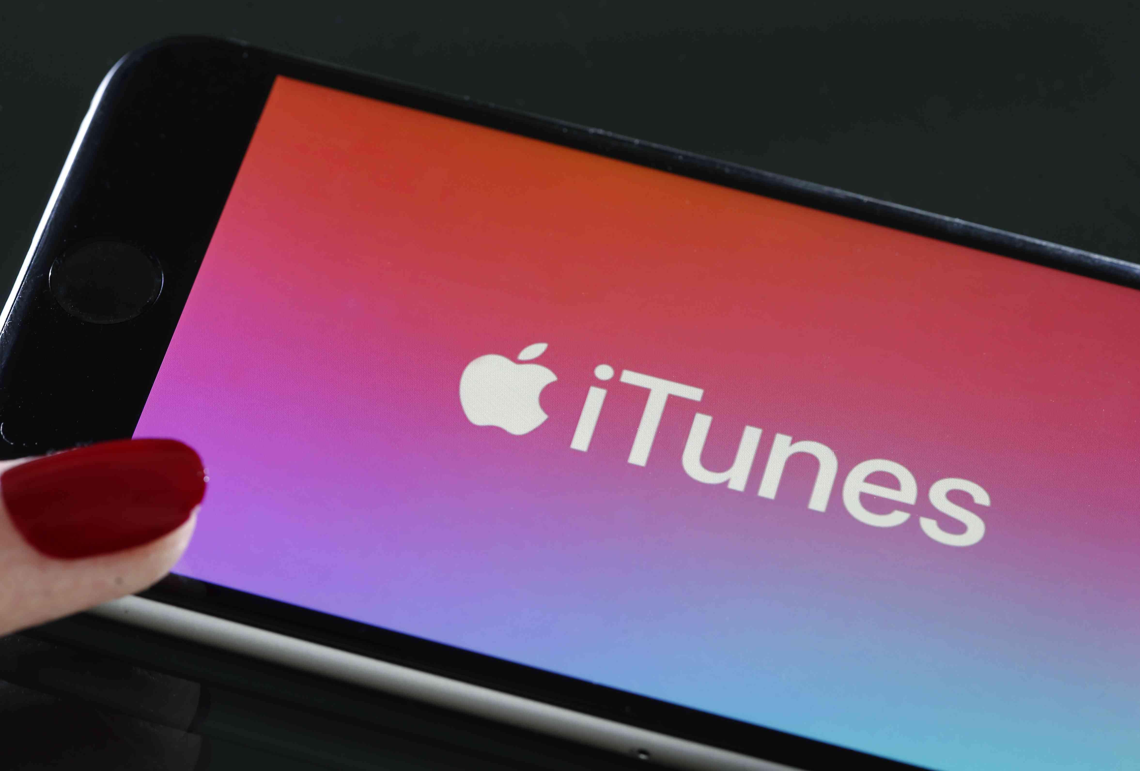 iTunes logo on smartphone.