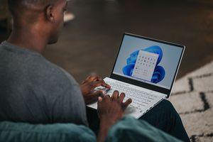 Man using Windows 11 on a laptop