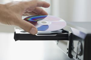 A hand placing a DVD into a Slide tray