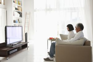 Older couple watching a Sony TV in light-filled living room