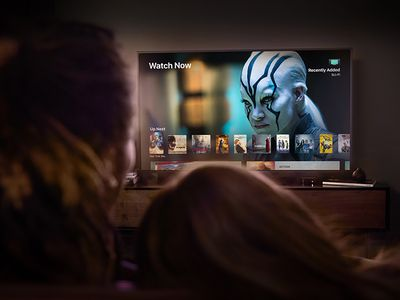 A photo of a couple watching TV using their Apple TV