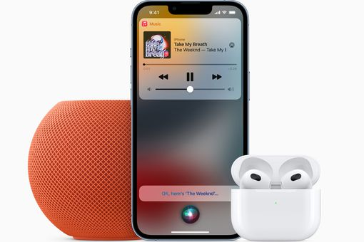 Apple Music on iPhone next to orange HomePod and AirPods