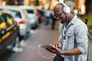 Person listening to music on iPad