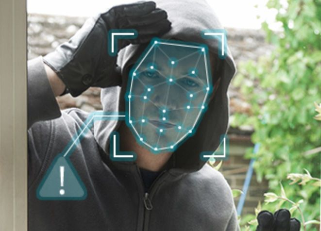 Facial recognition dots on face peering into a home window