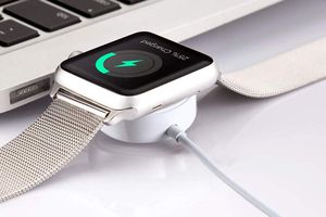 Apple Watch charging next to computer