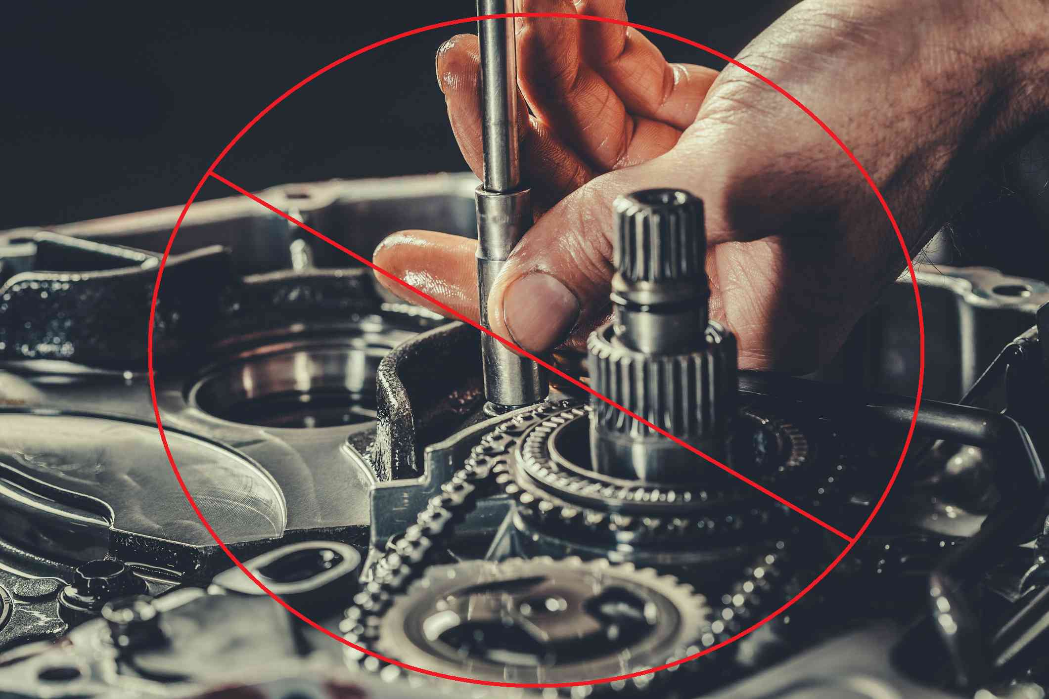 A closeup of a transmission repair with the No symbol superimposed over the top.