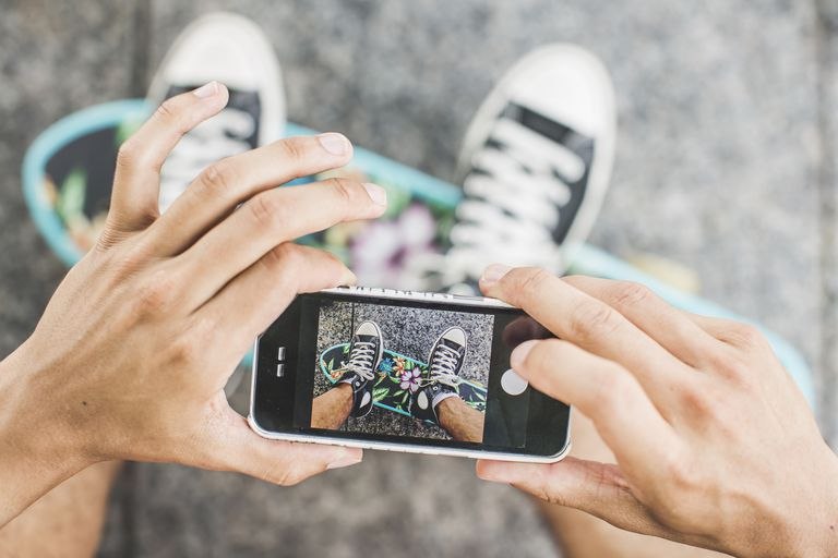 Taking a photo of feet on a skateboard on an iPhone