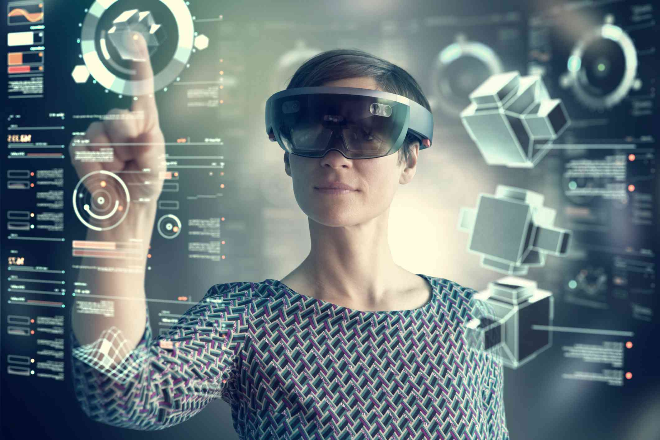 Person tapping virtual interface elements while wearing VR glasses