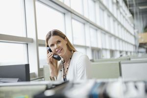 Woman using phone in business setting