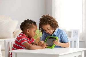 Children playing with LeapFrog Epic Academy Edition