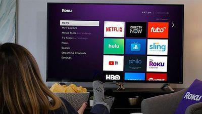 Woman watching Roku Tv