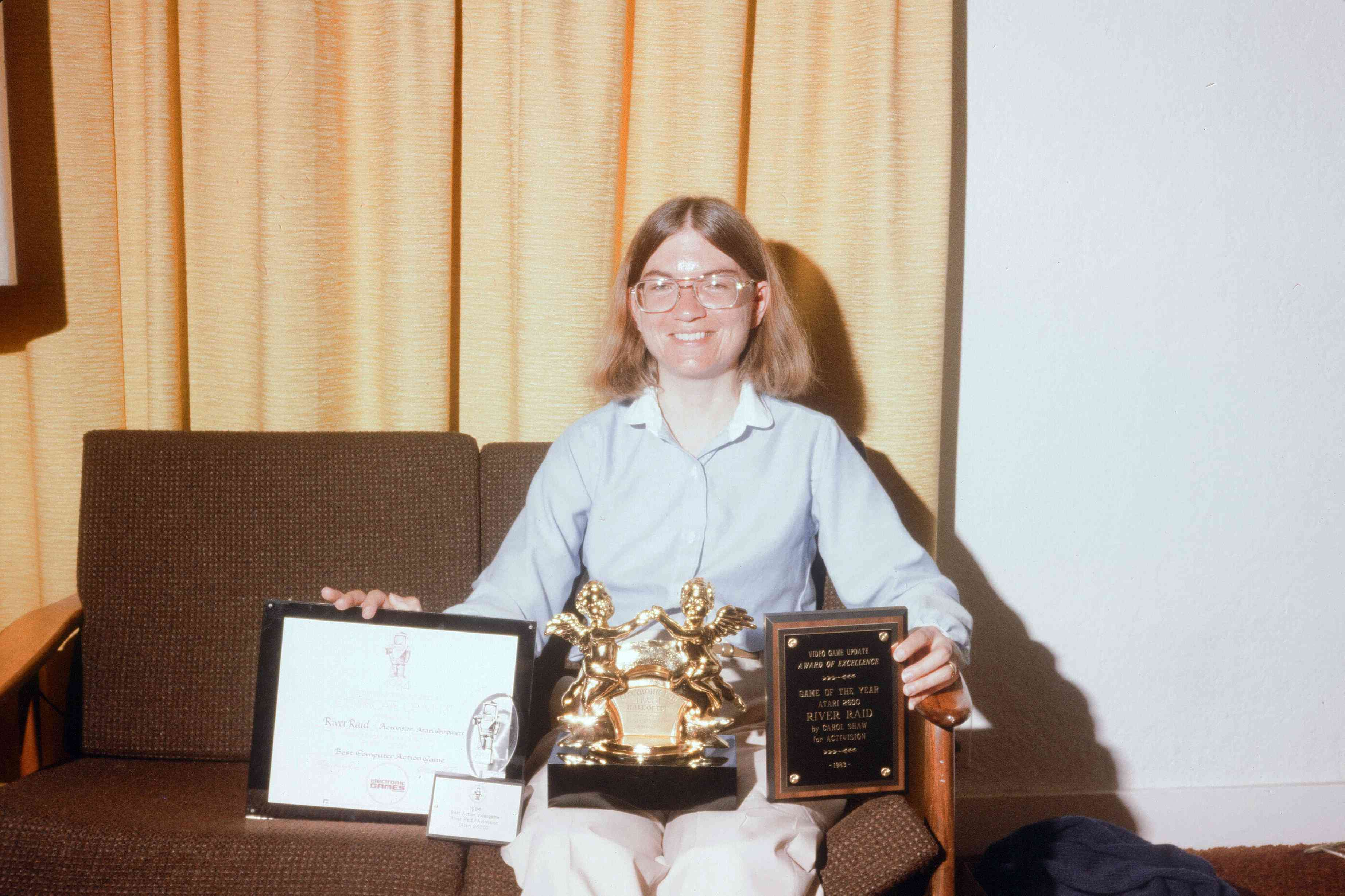 Carol Shaw holds her numerous video game awards.